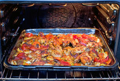 Spicy chicken wings with vegetables Stock Photo