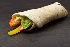Spicy Chicken Wrap. Spicy chicken with salad and salsa wrapped in a soft flour tortilla Royalty Free Stock Photos