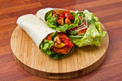 Spicy Chicken Wrap. Spicy chicken with salad and salsa wrapped in a soft flour tortilla Royalty Free Stock Photography