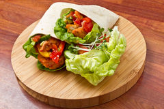 Spicy Chicken Wrap. Spicy chicken with salad and salsa wrapped in a soft flour tortilla Stock Image