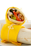 Spicy Chicken Wrap. Delicious spicy chicken wraps in tortillas ready to serve Royalty Free Stock Photos