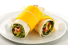 Spicy Chicken Wrap. Delicious spicy chicken wraps in tortillas ready to serve Royalty Free Stock Images