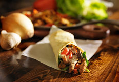 Spicy chicken wrap shot in panorama. And with selective focus Stock Photos