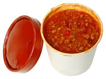 Spicy Chili in a Carryout Cardboard Cup. Healthy fast food to go. Spicy chili in a carryout cardboard cup over white Stock Photo