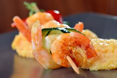 Spicy chili prawn skewers and polenta Stock Photography