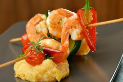 Spicy chili prawn skewers and polenta Royalty Free Stock Photos
