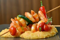 Spicy chili prawn skewers and polenta Royalty Free Stock Photo