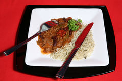 Spicy Chilli and Saffron Rice. A tasty meal of Chilli con Carne served with Saffron rice royalty free stock image