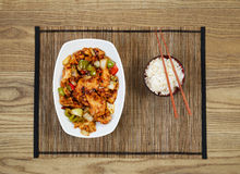 Spicy Chinese Chicken Dish with Bowl of Rice Stock Photo