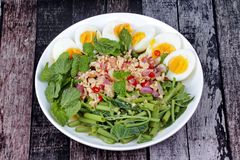 Spicy Chinese morning glory salad with boiled egg topped pork ch Royalty Free Stock Photos