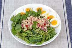 Spicy Chinese morning glory salad with boiled egg topped pork ch Stock Photo