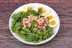 Spicy Chinese morning glory salad with boiled egg topped pork ch Stock Photos