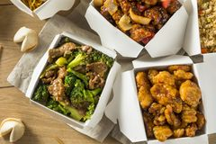 Spicy Chinese Take Out Food. With Chopsticks and Fortune Cookies stock images