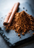 Spicy cinnamon stick. Cinnamon stick in mystic light on stone plate Stock Images