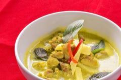 Spicy ckhicken-curry in coconut milk. Spicy chicken-curry in coconut milk on red background Stock Images