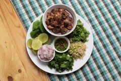 Spicy cockles salad. Thai original local spicy food royalty free stock image