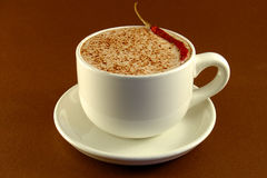 Spicy Cocoa. This is an image of a Spicy Cocoa drink, garnished with a chili pepper and chili powder Stock Image