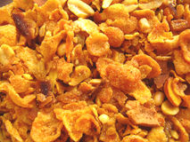 Spicy Corn Flakes. Corn flakes fried in oil and mixed up with salt,spices and nuts.It is eaten as a snack in india Stock Image