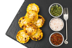 Spicy corn grill on black stone Royalty Free Stock Photography