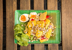 Spicy corn salad. Spicy corn salad with roasted peanuts and salted egg. Top view. Thai style food Stock Photography