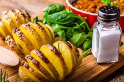 Spicy cowboy beans with hassleback potatoe with herbs Royalty Free Stock Photography