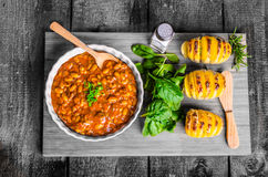 Spicy cowboy beans with hassleback potatoe with herbs Royalty Free Stock Image