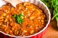 Spicy cowboy beans with hassleback potatoe with herbs Stock Image