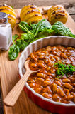 Spicy cowboy beans with hassleback potatoe with herbs Royalty Free Stock Images