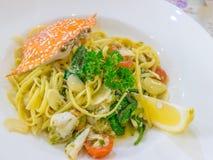 Spicy crab spaghetti. Delicious spicy crab spaghetti on white plate ready to eat Stock Photos