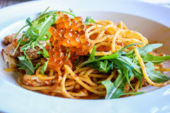 Spicy crab spaghetti topped with salmon eggs, Thai food style Royalty Free Stock Photos
