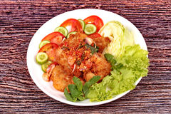 Spicy crispy deep-fried chicken salad. Royalty Free Stock Image