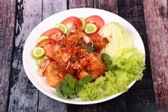 Spicy crispy deep-fried chicken salad. Stock Image