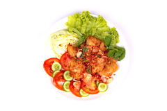 Spicy crispy deep-fried chicken salad. Royalty Free Stock Photography