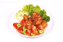 Spicy crispy deep-fried chicken salad. Stock Photos