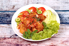 Spicy crispy deep-fried chicken salad. Stock Images