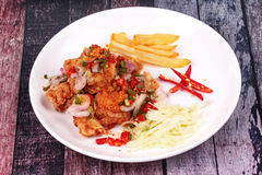 Spicy crispy deep-fried Karaoge chicken salad. Thai spicy recipe, Spicy crispy deep-fried Karaoge chicken salad call Yum Kai Zap in Thai topped sliced cabbage Stock Photography