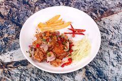 Spicy crispy deep-fried Karaoge chicken salad. Thai spicy recipe, Spicy crispy deep-fried Karaoge chicken salad call Yum Kai Zap in Thai topped sliced cabbage Stock Image