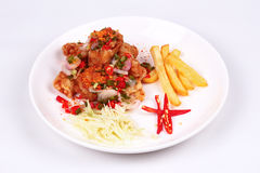 Spicy crispy deep-fried Karaoge chicken salad. Thai spicy recipe, Spicy crispy deep-fried Karaoge chicken salad call Yum Kai Zap in Thai topped sliced cabbage Royalty Free Stock Images
