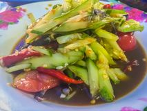 Spicy cucumber salad, Thai street food with tomato and chilli on dish. This spicy Thai cucumber salad has a classic Asian flavor,. With a touch of sweetness and Royalty Free Stock Images
