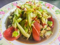 Spicy cucumber salad, Thai street food with tomato and chilli on dish. This spicy Thai cucumber salad has a classic Asian flavor,. With a touch of sweetness and royalty free stock image