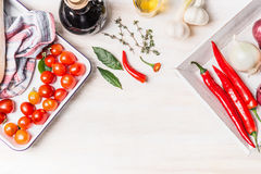Spicy cuisine with variety of fresh spices and ingredients on white wooden background, top view, border Royalty Free Stock Photos