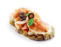 Spicy cured German schinken ham on bread stock photos