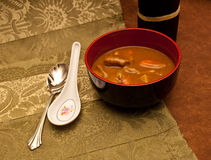 Spicy Curry for a Cold Night. Beef Curry with Soup Spoons on a placemat Royalty Free Stock Photo