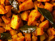 Spicy curry potatoes Stock Photo