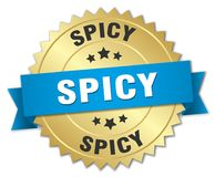 Spicy 3d gold badge. With blue ribbon Stock Photography