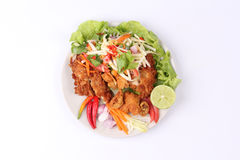Spicy deep-fried chicken salad with roll green mango . Royalty Free Stock Photos