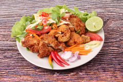 Spicy deep-fried chicken salad with roll green mango . Royalty Free Stock Photo