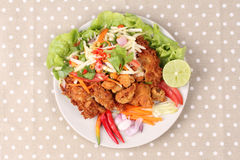 Spicy deep-fried chicken salad with roll green mango . Royalty Free Stock Images