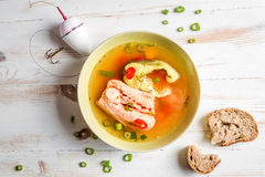 Spicy fish soup based on salmon. On old wooden table Royalty Free Stock Photo
