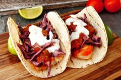 Spicy fish tacos with cabbage slaw, salsa and sour cream Stock Image
